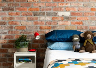recycled brick walls in bedroom