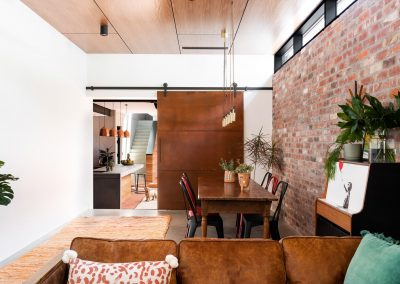 living area with brick wall